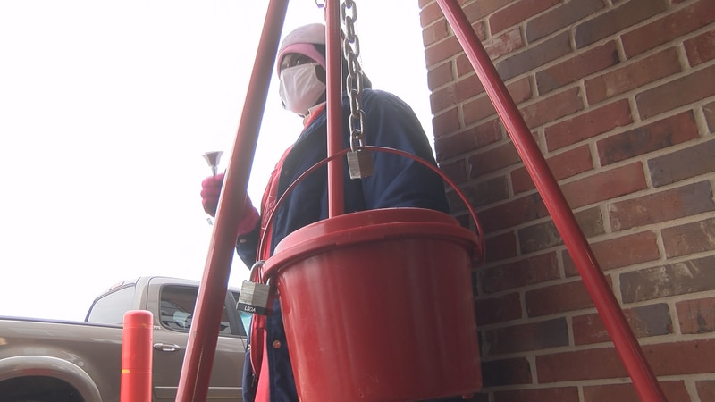 Shirley Ford rings a bell for the Salvation Army at the Corner Market at Midtown Thursday.