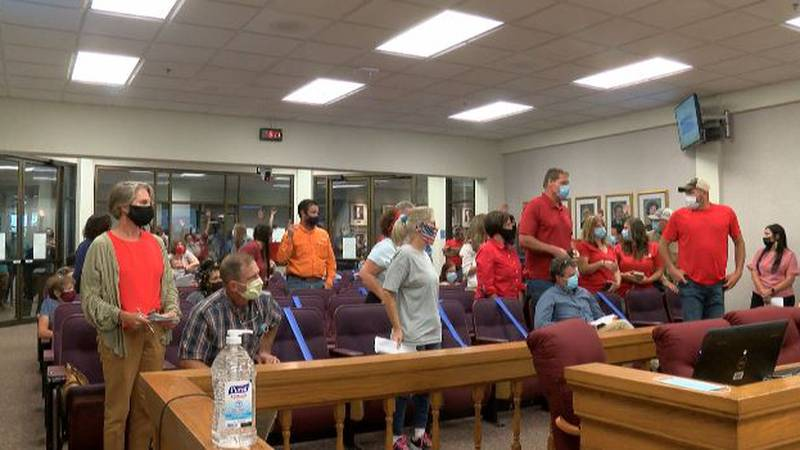 Residents opposing the solar project stood to show their numbers
