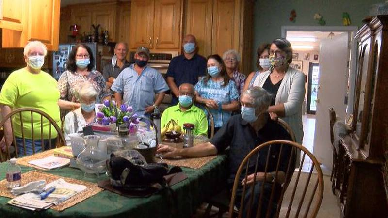 A group of about 10 people who have been attending private masses gathered to support Father...