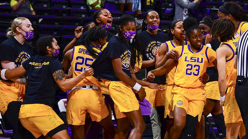 The LSU women's basketball team celebrates after Karli Seay (23) knocks down a 3-pointer late...