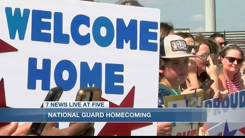 As the Sun Country Airlines plane made it's grand entrance, family members held on to signs...