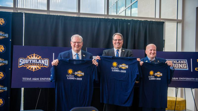 Southland Conference Commissioner Tom Burnett and Texas A&M-Commerce officials celebrate the...