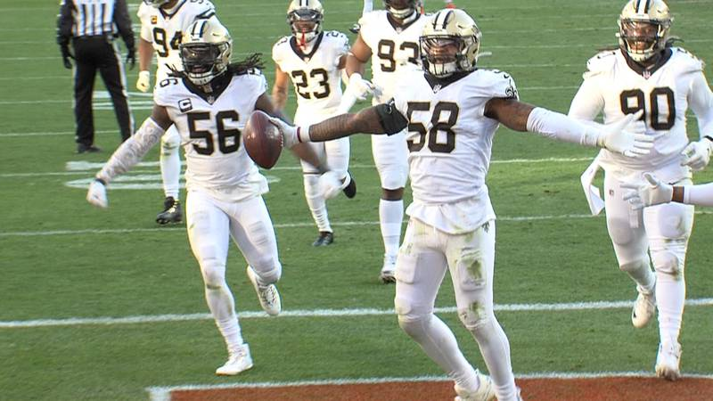 Saints linebacker Kwon Alexander celebrates with teammates after recovering a fumble