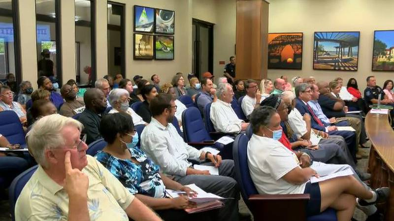 The Council Chambers was filled with interested citizens. Overflow crowd stood in the hall.
