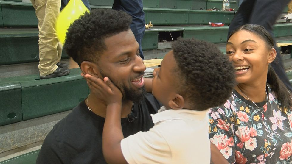 Malcom Patterson enjoys the night with his son, Liam, 4, at a STEAM event hosted by the...