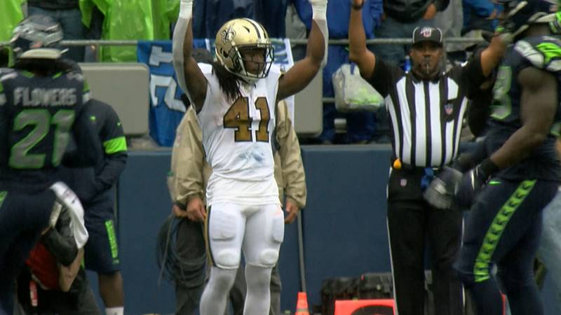 Saints running back Alvin Kamara celebrates his touchdown catch-and-run by mimicking the...