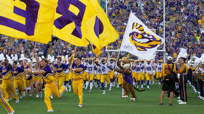 LSU's football team makes a dramatic entrance in front of fans at Tiger Stadium in Baton Rouge