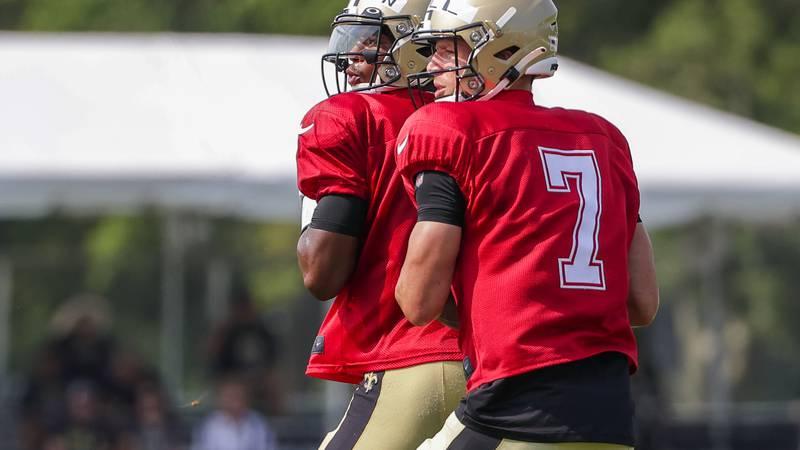 New Orleans Saints quarterback Taysom Hill (7) and quarterback Jameis Winston (2) throw during...