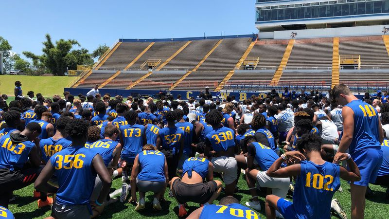 Frank Wilson speaks to football camp participants