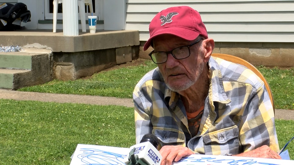 94-year-old WWII Homer Denham received a special surprise Saturday as dozens of vehicles drove...
