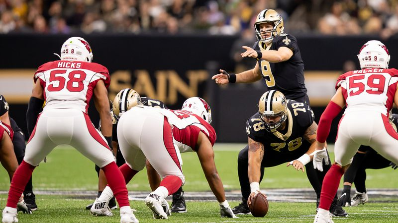 Saints center Erik McCoy readies to snap the ball as Drew Brees audibles at the line of scrimmage