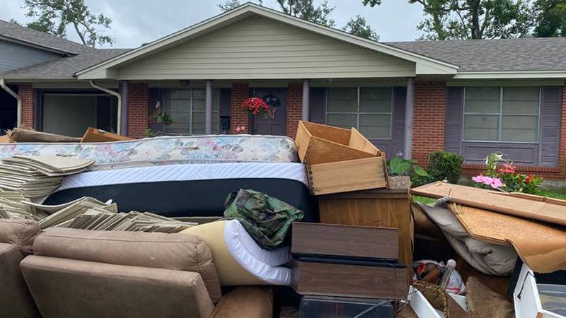 Homes on Tamarack Street lost most of their furniture which was soaked by about two feet of...