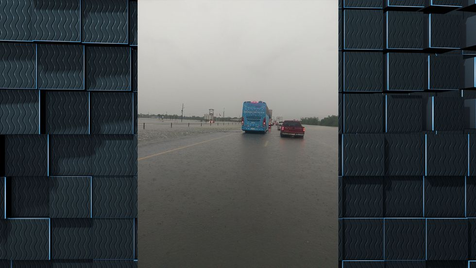 Jeff Davis resident Phil Legros ended up stuck on I-10 Thursday morning after heavy rains from...
