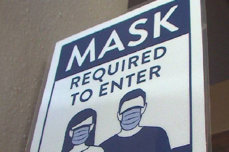 File photo of a mask required sign