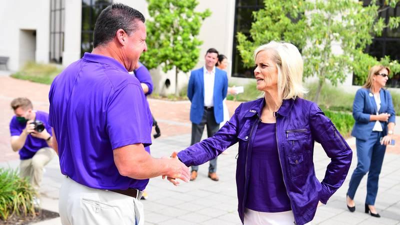 Kim Mulkey does an impression of LSU head football coach Ed Orgeron as she visits the LSU...