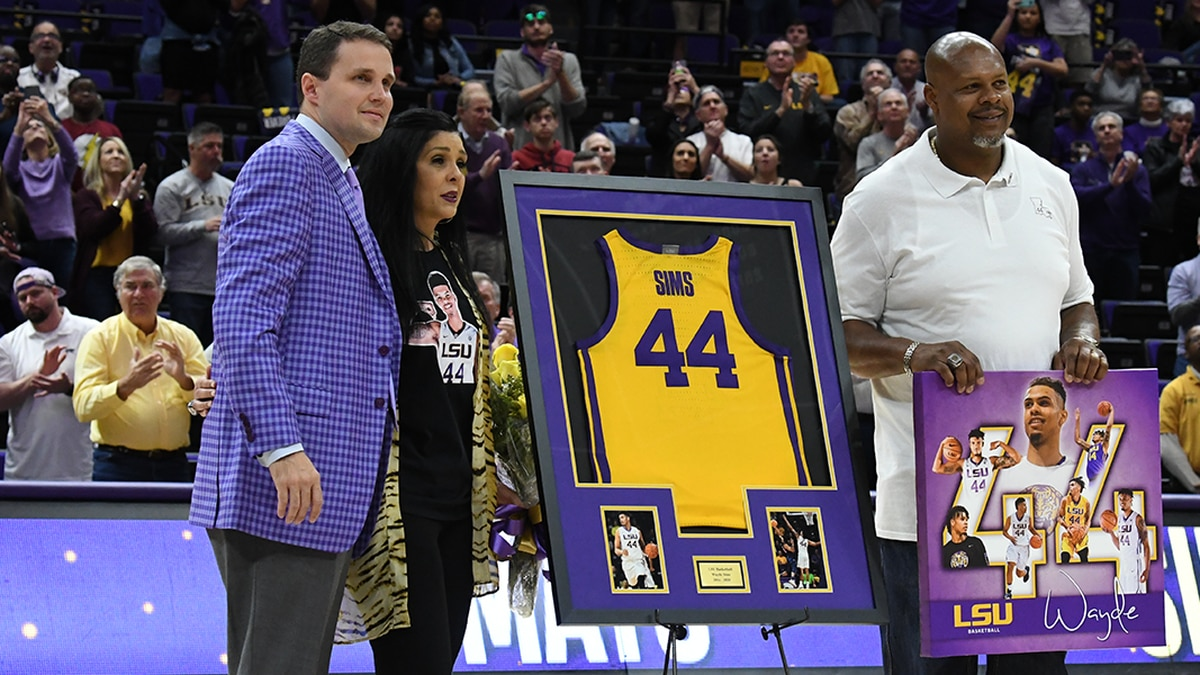 As players marched across the court hand-in-hand with their loved ones, the family of slain...