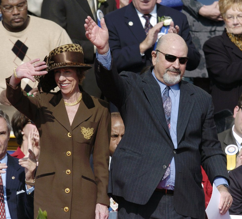 Former Louisiana Gov. Mike Foster and his wife Alice acknowledge the crowd at the inauguration...