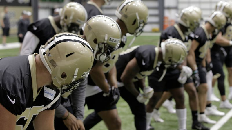 New Orleans Saints players line up in the team's indoor facility during 2019 organized team...