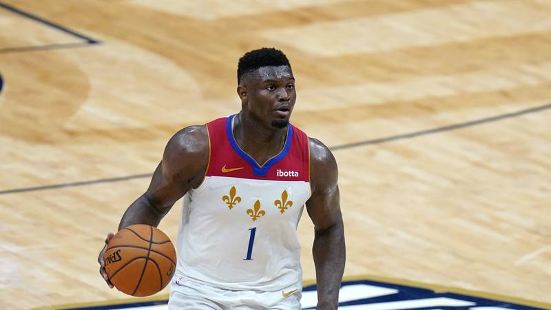 New Orleans Pelicans forward Zion Williamson (1) moves the ball up court in the second half of...