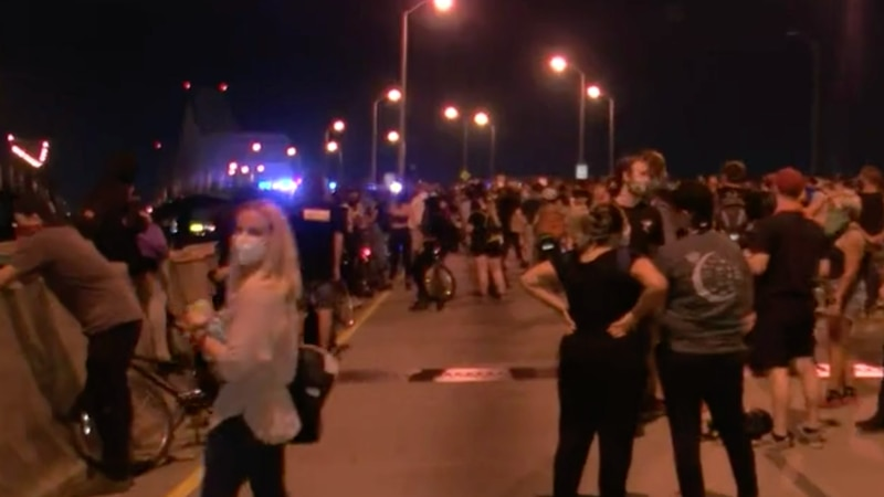 The New Orleans Police Department fired tear gas on protesters to prevent them from crossing...