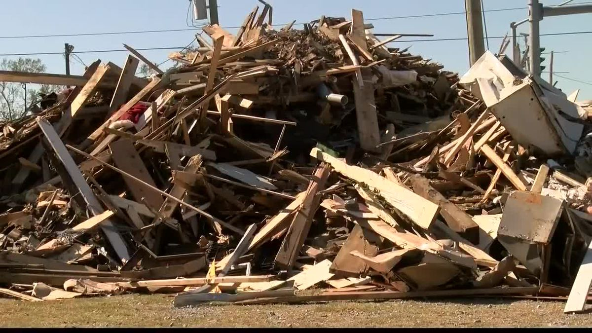 This mountain of debris is from the Brimstone Museum in Sulphur which was too severely damaged...