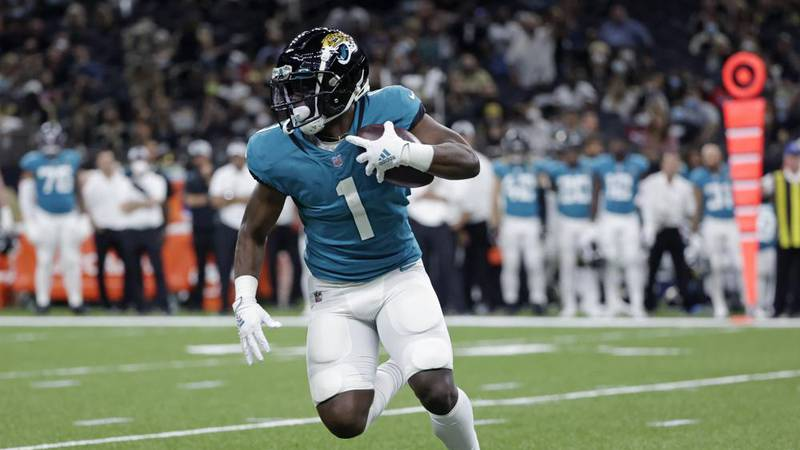 Jacksonville Jaguars running back Travis Etienne (1) carries in the first half of an NFL...
