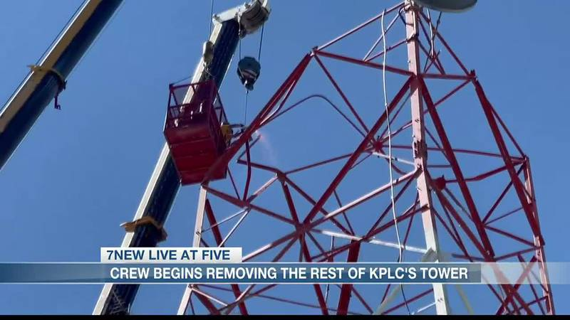 Crew members begin removing the rest of KPLC Tower Friday afternoon.