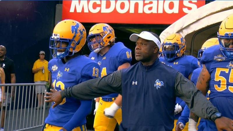 McNeese coach Frank Wilson leads the Cowboys out of the tunnel in Tiger Stadium.