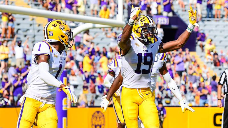 LSU linebacker Jabril Cox (No. 19) celebrates intercepting a pass against Mississippi State and...