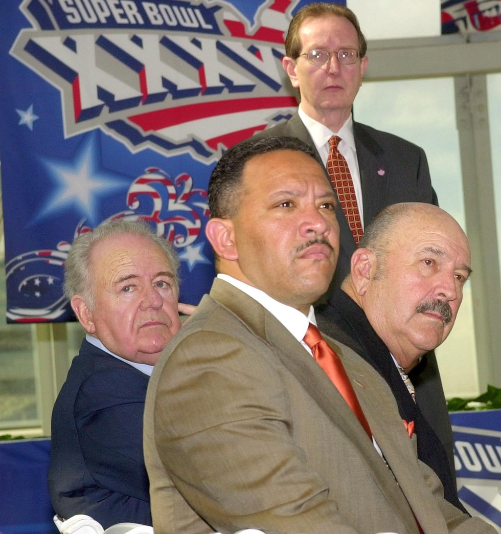 From left: New Orleans Saints owner Tom Benson, New Orleans Mayor Marc Morial, and Louisiana...