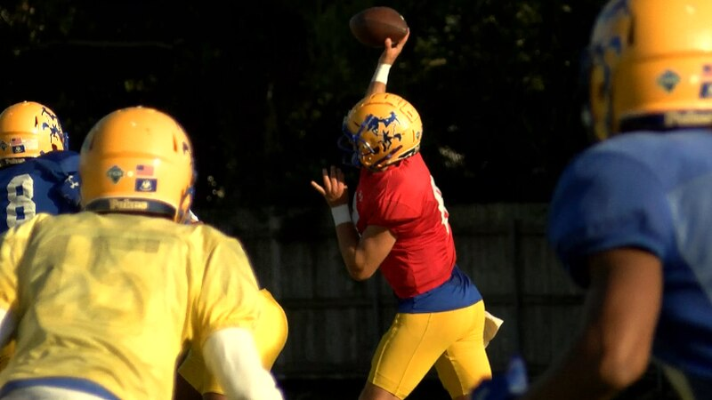 QB Cody Orgeron throwing a pass in practice