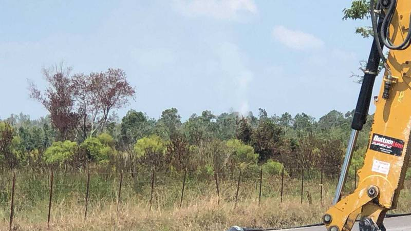 A plume of crude oil-mixture can be seen gushing into the air south of Lake Charles a day after...