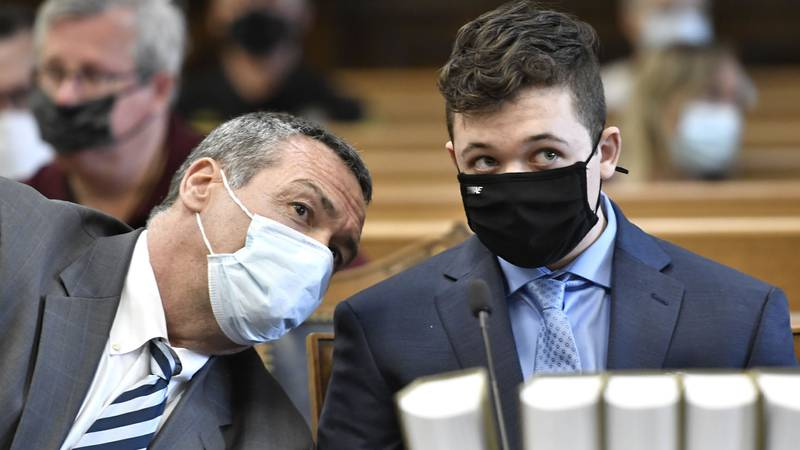 In this May 21, 2021 file photo, Kyle Rittenhouse, right, listens to his attorney, Mark...