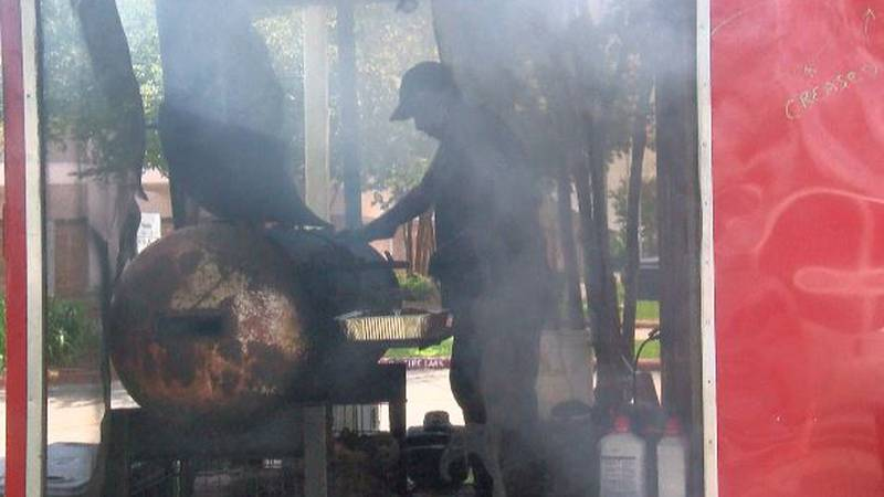Joe Fields cooks chicken to sell from one of two food trucks he and his wife have operated...