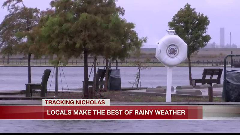 Locals make the best of rainy weather