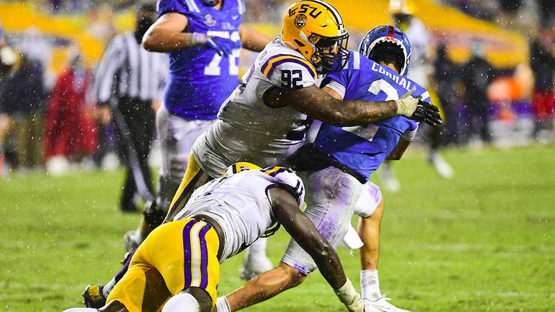 LSU defensive lineman Ali Gaye (11) and defensive end Neil Farrell Jr. (92) get to Ole Miss...