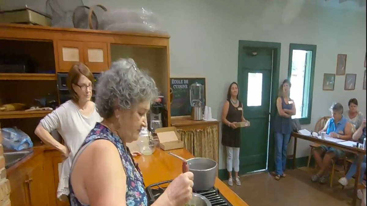 Vermilionville instructors Mary Perrin and Mary Ann Armbruster demonstrate how to make some of...