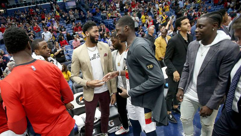 """Davis was sporting a """"That's all folks"""" shirt at the Pelicans game. (Source: Nola.com)"""