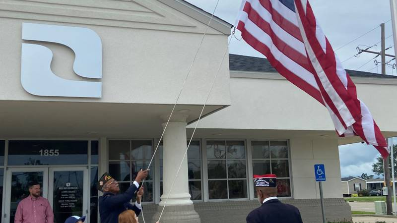 Members of the VFW and Cub Scouts raise the American flag recently.