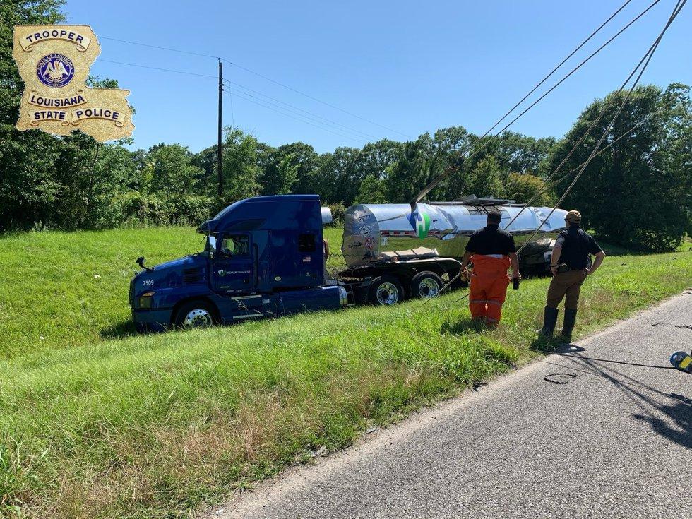 Crews turn a tractor trailer upright after it overturned on I-10 Eastbound near Ambassador...