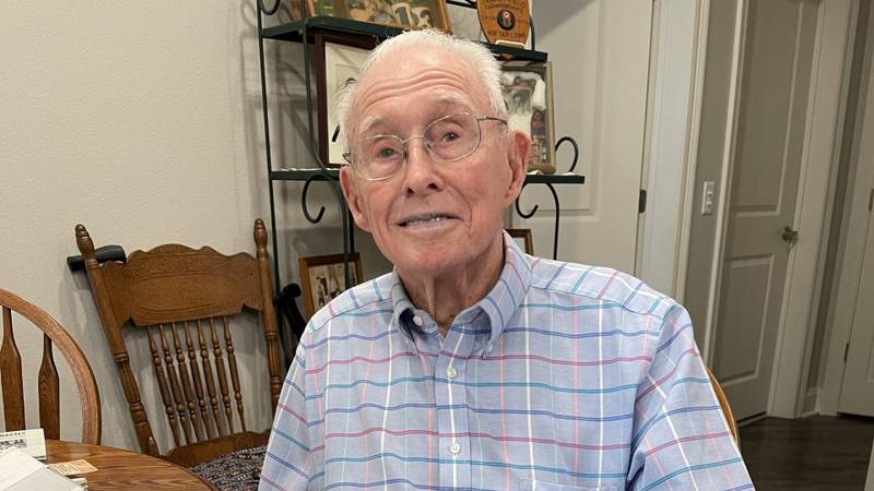 Rev. Walker holds recent 97th birthday mail