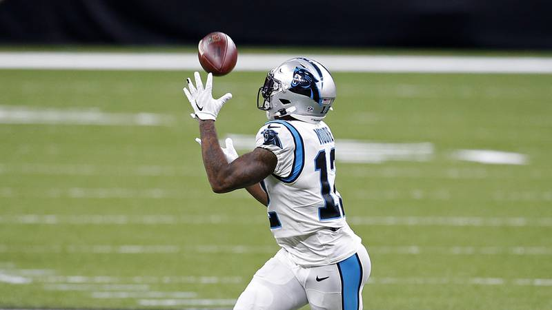 Carolina Panthers wide receiver D.J. Moore (12) pulls in a 74-yard touchdown reception in the...