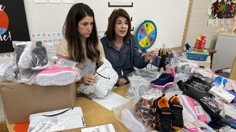 Teachers collect shoes for students