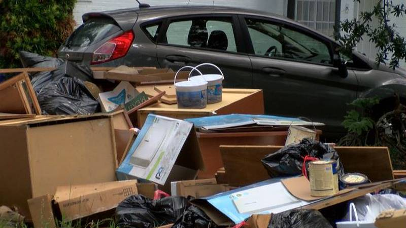 Residents on Cherrydale continue to place  soaked furniture and belongings along the road for...