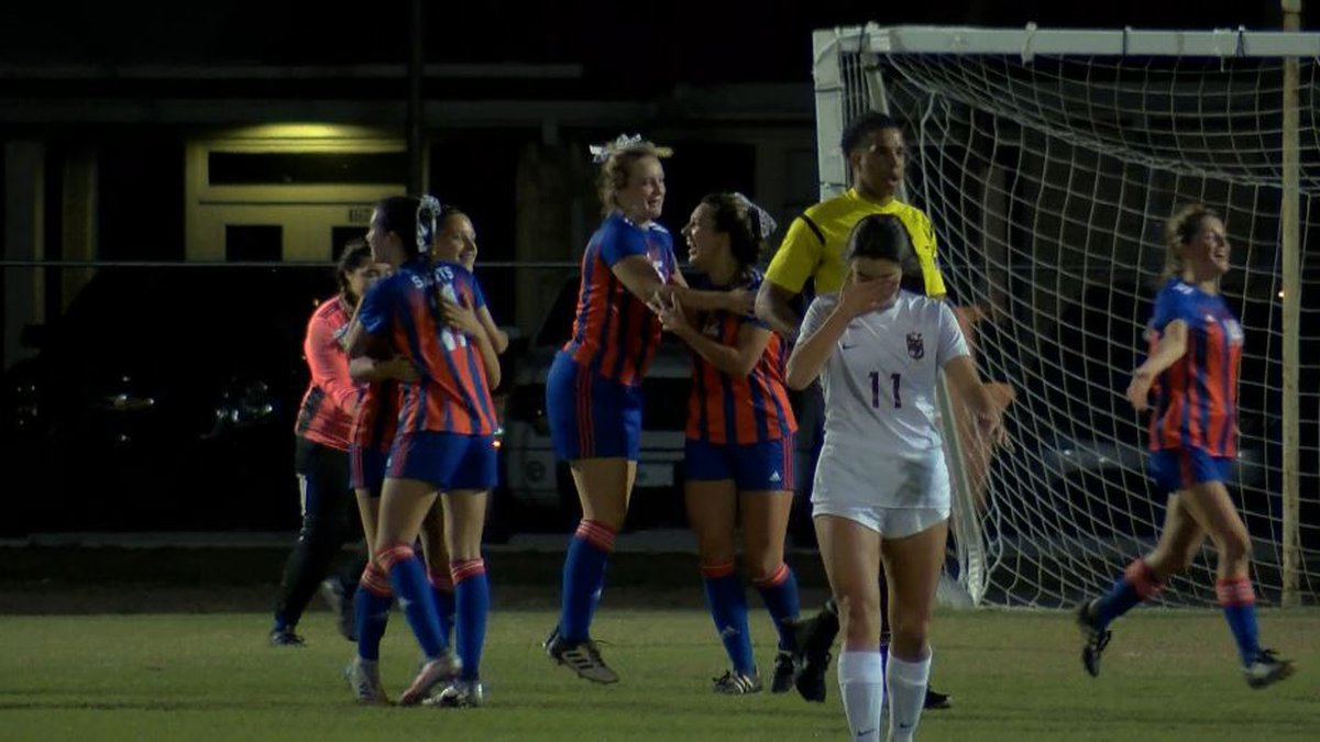 The Lady Saints celebrate their second-round win over Hannan, 2-1.
