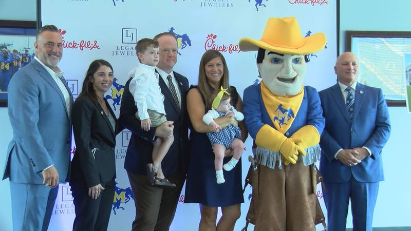 (L-R) Heath Schroyer, Clerc Bertrand, David Griffin with son, Kimberly Griffin with daughter,...