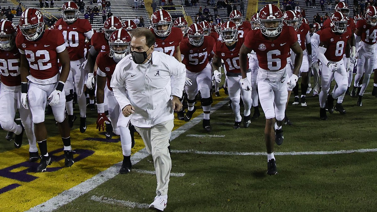 Alabama head coach Nick Saban leads his Crimson Tide team onto the field to face LSU at Tiger...
