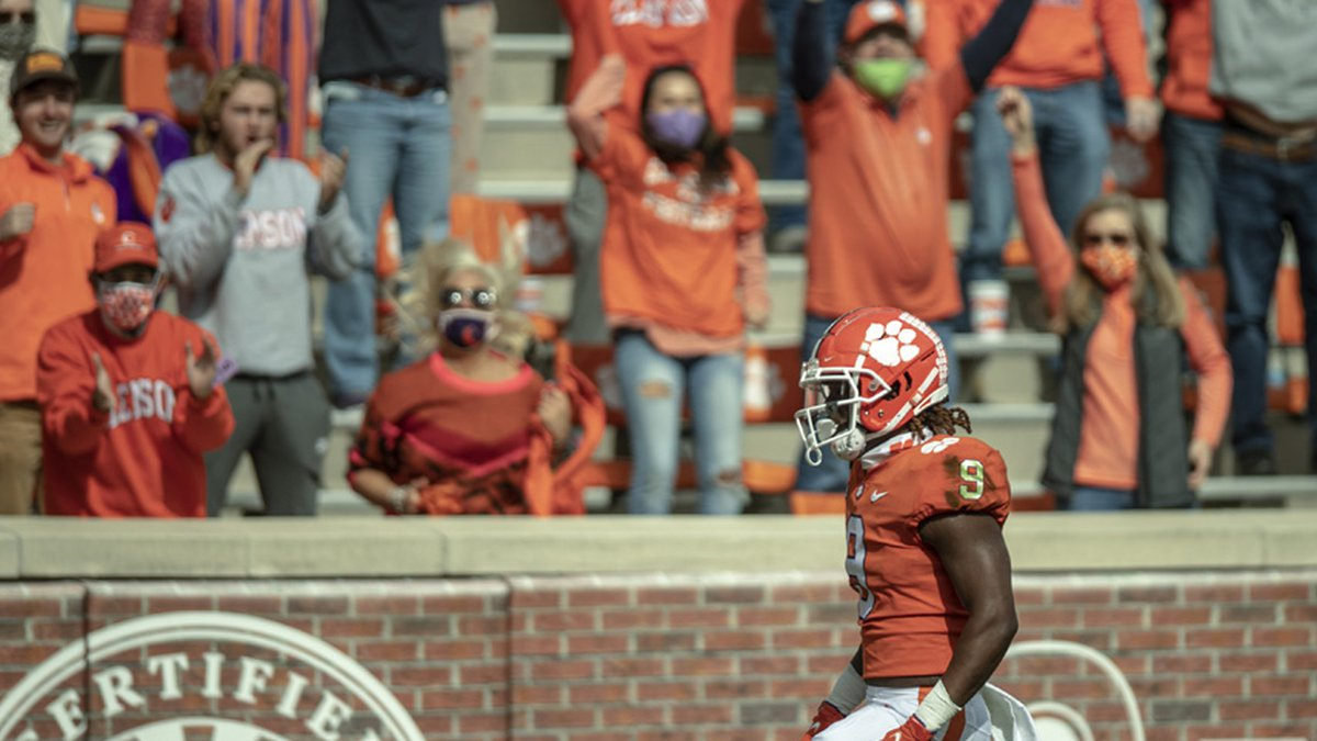 Clemson running back Travis Etienne(9) finishes in the end zone after a 35-yard pass catch...