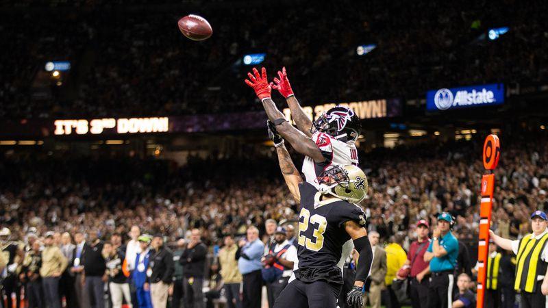 Saints CB Marshon Lattimore leaps to contest a ball thrown to Falcons WR Julio Jones