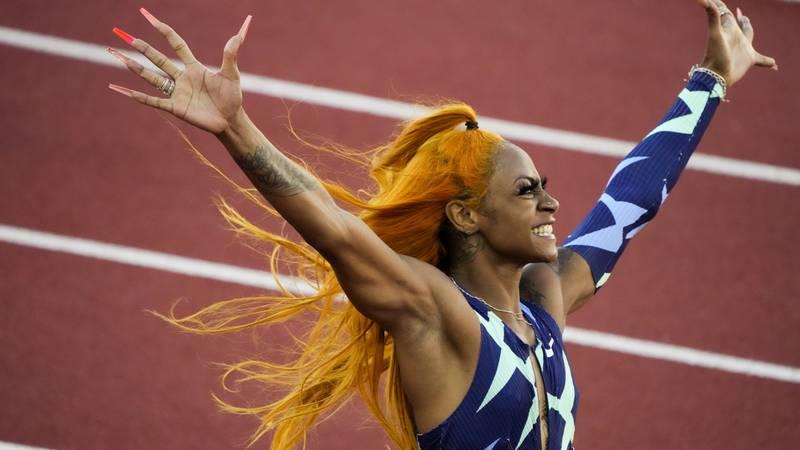 Sha'Carri Richardson celebrates after winning the women's 100-meter run at the U.S. Olympic...